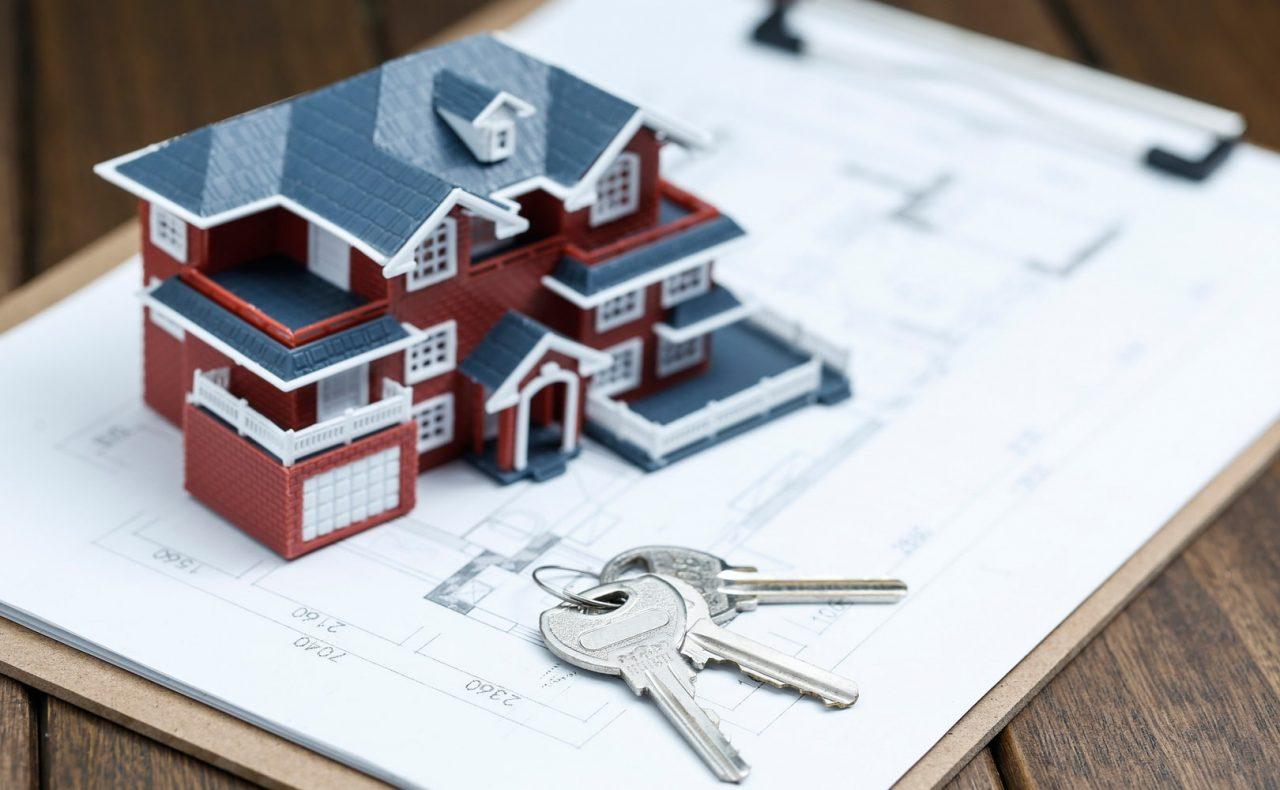 villa-house-model-key-drawing-retro-desktop-real-estate-sale-concept-min